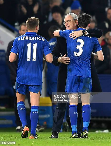 Claudio Ranieri Manager of Leicester City and Ben Chilwell of Leicester City celebrate victory during the Premier League match between Leicester City...
