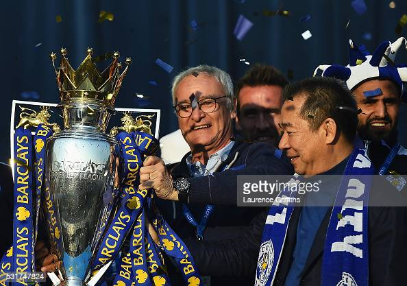 Claudio Ranieri Manager of Leicester City and Vichai Srivaddhanaprabha the club owner show the trophy to the fans during the Leicester City Barclays...