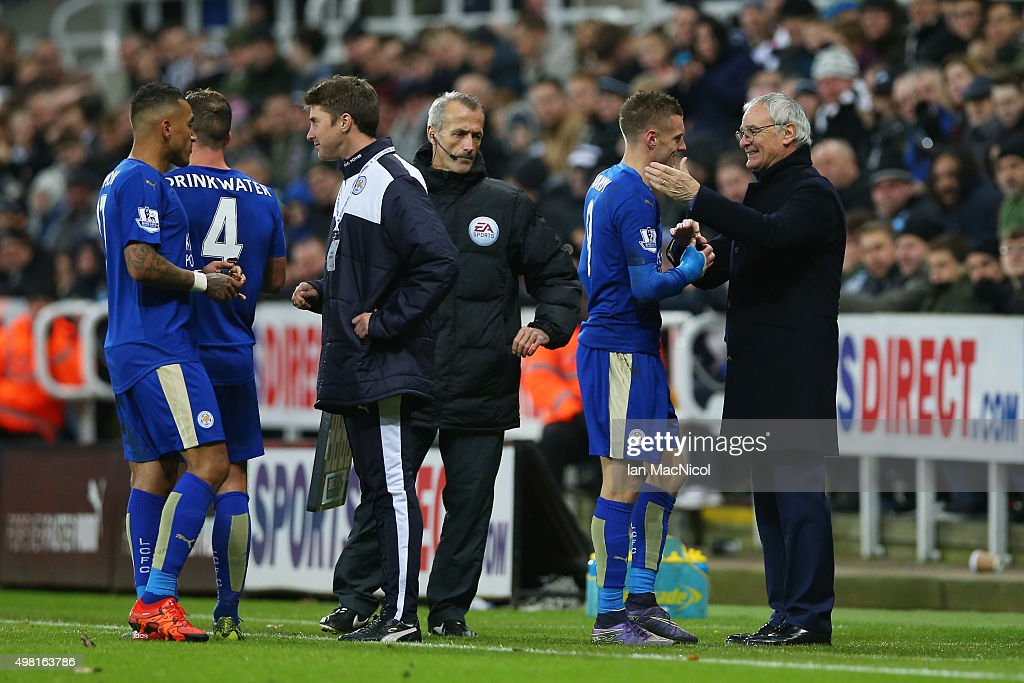 Claudio Ranieri (1st R) Manager of Leicester City congratulates Jamie Vardy (2nd R) after replacing him during the Barclays Premier League match between Newcastle United and Leicester City at St James' Park on November 21, 2015 in Newcastle upon Tyne, England.