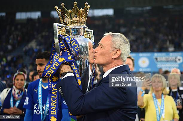 Claudio Ranieri Manager of Leicester City kisses the Premier League Trophy after the Barclays Premier League match between Leicester City and Everton...