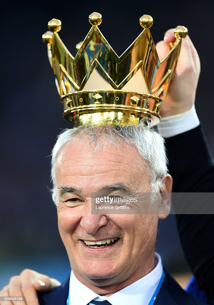 Claudio Ranieri Manager of Leicester City poses with the crown of the Premier League Trophy after the Barclays Premier League match between Leicester City and Everton at The King Power Stadium on May 7, 2016 in Leicester, United Kingdom.