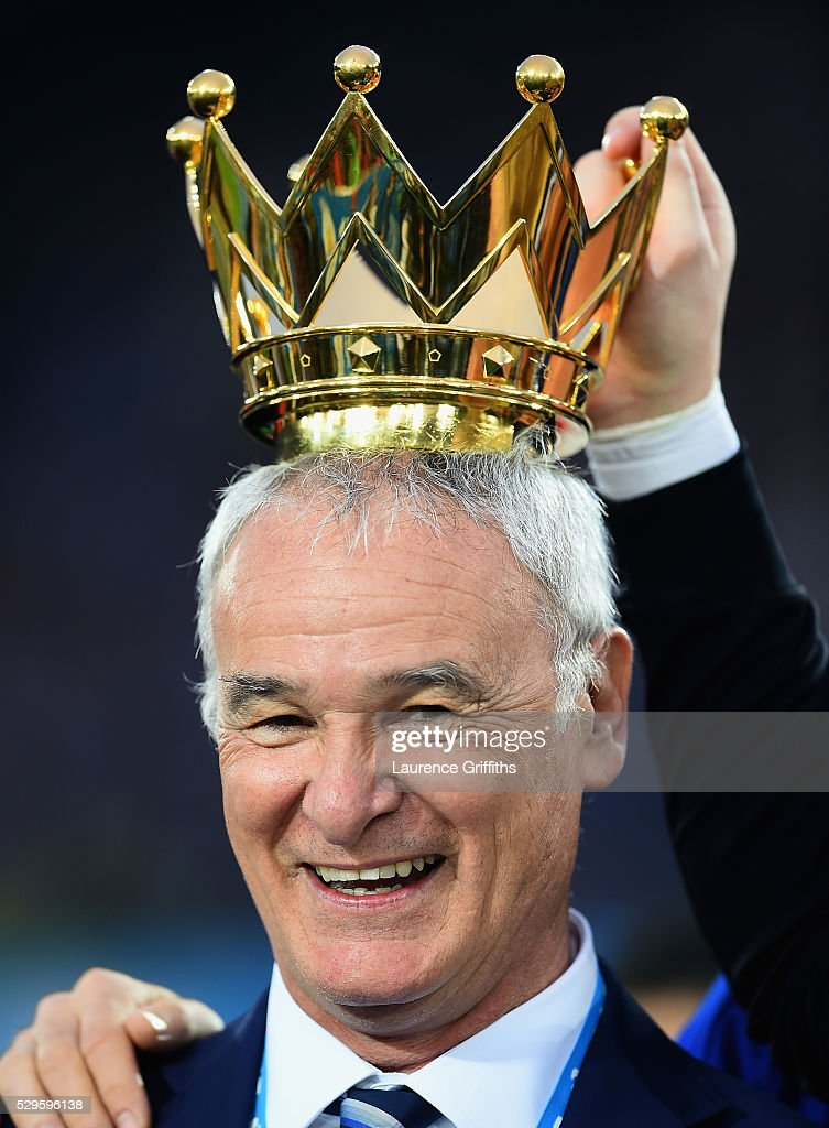 Claudio Ranieri Manager of Leicester City poses with the crown of the Premier League Trophy afterthe Barclays Premier League match between Leicester City and Everton at The King Power Stadium on May 7, 2016 in Leicester, United Kingdom.