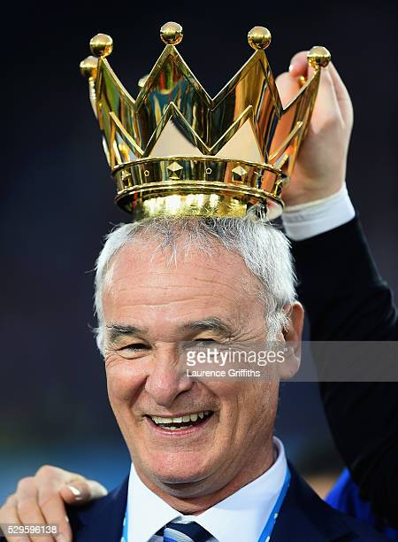 Claudio Ranieri Manager of Leicester City poses with the crown of the Premier League Trophy afterthe Barclays Premier League match between Leicester...