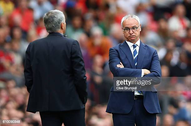 Claudio Ranieri Manager of Leicester City shows his frustration as Jose Mourinho Manager of Manchester United looks on during the Premier League...