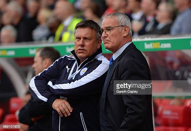 Claudio Ranieri Manager of Leicester City talks with assistant manager Craig Shakespeare during the Barclays Premier League match between Stoke City...