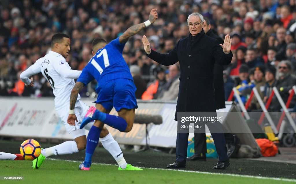 Claudio Ranieri manager of Leicester City watches Danny Simpson of Leicester City and Martin Olsson of Swansea City in action during the Premier League match between Swansea City and Leicester City at Liberty Stadium on February 12, 2017 in Swansea, Wales.