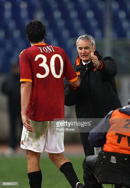 Claudio Ranieri the coach of AS Roma congratulales Luca Toni during the Serie A match between Roma and Chievo at Stadio Olimpico on January 9 2010 in...