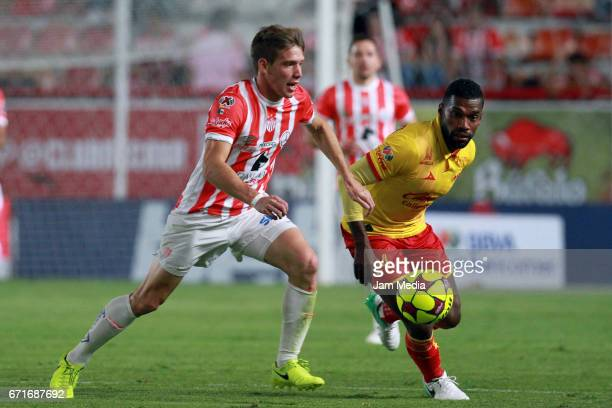 Claudio Riano of Necaxa fihgts for the ball with Gabriel Achilier of Morelia during the 15th round match between Necaxa and Morelia as part of the...