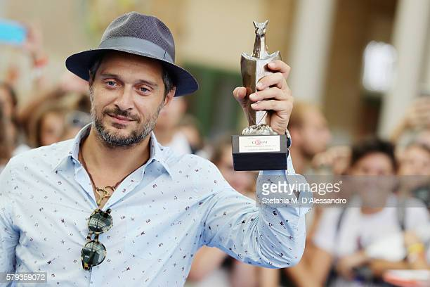 Claudio Santamaria poses with the Giffoni Experience Award during Giffoni Film Festival Day 9 blue carpet on July 23 2016 in Giffoni Valle Piana Italy