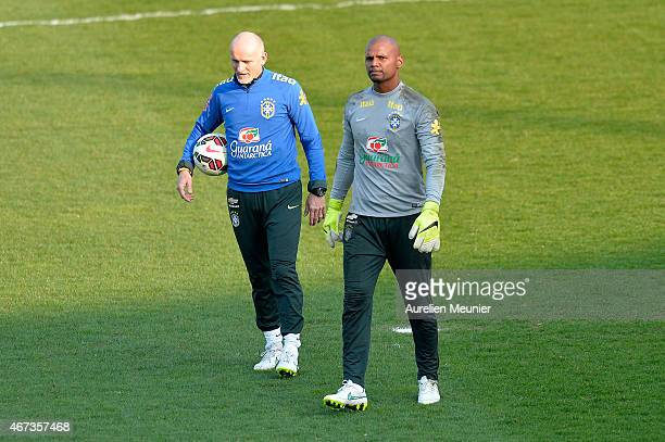 Claudio Taffarel goalkeeper Coach and Jefferson of Brazil reacts during a team practice ahead of their international friendly game against France at...