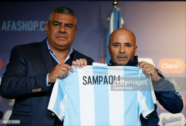 Claudio Tapia President of AFA and Jorge Sampaoli coach of Argentina show his jersey during the presentation as new Argentina coach at Argentine...