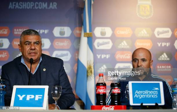 Claudio Tapia President of AFA and Jorge Sampaoli coach of Argentina's soccer team look on during his presentation as new Argentina coach at...