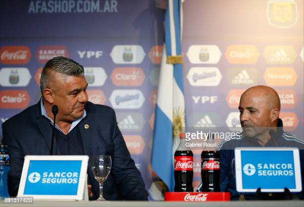 Claudio Tapia President of AFA and Jorge Sampaoli coach of Argentina's soccer team gesture during his presentation as new Argentina coach at...