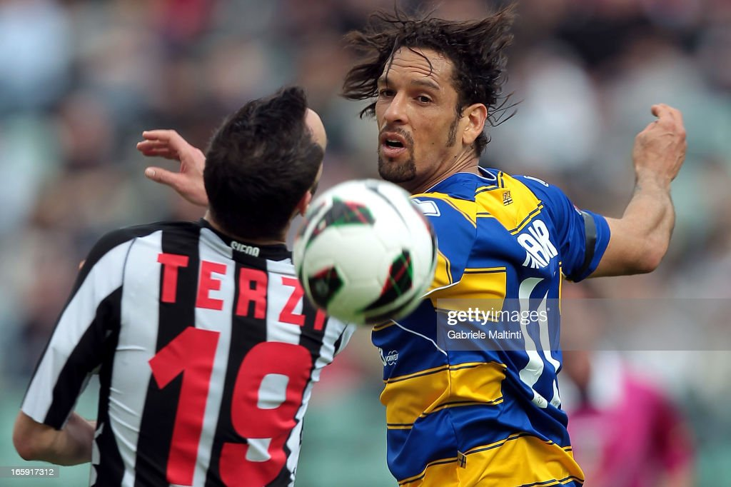 Claudio Terzi of AC Siena fights for the ball with Amauri of Parma FC during the Serie A match between AC Siena and Parma FC at Stadio Artemio Franchi on April 7, 2013 in Siena, Italy.