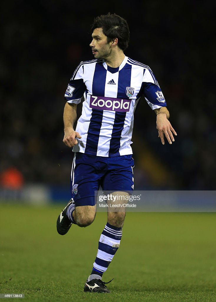 <a gi-track='captionPersonalityLinkClicked' href=/galleries/search?phrase=Claudio+Yacob&family=editorial&specificpeople=4104249 ng-click='$event.stopPropagation()'>Claudio Yacob</a> of West Brom in action during the Barclays Premier League match between West Bromwich Albion and Chelsea at The Hawthorns on February 11, 2014 in West Bromwich, England. (Photo by
