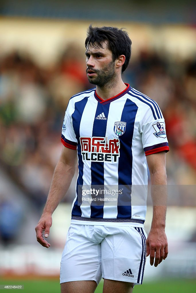 <a gi-track='captionPersonalityLinkClicked' href=/galleries/search?phrase=Claudio+Yacob&family=editorial&specificpeople=4104249 ng-click='$event.stopPropagation()'>Claudio Yacob</a> of West Brom in action during the Pre-Season Friendly between Walsall and West Bromwich Albion at Banks' Stadium on July 28, 2015 in Walsall, England.