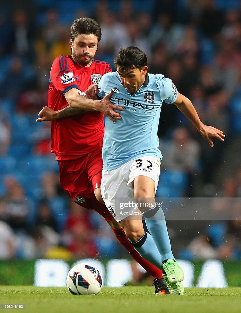 <a gi-track='captionPersonalityLinkClicked' href=/galleries/search?phrase=Claudio+Yacob&family=editorial&specificpeople=4104249 ng-click='$event.stopPropagation()'>Claudio Yacob</a> of West Bromwich Albion competes with <a gi-track='captionPersonalityLinkClicked' href=/galleries/search?phrase=Carlos+Tevez&family=editorial&specificpeople=220555 ng-click='$event.stopPropagation()'>Carlos Tevez</a> of Manchester City during the Barclays Premier League match between Manchester City and West Bromwich Albion at the Etihad Stadium on May 07, 2013 in Manchester, England.