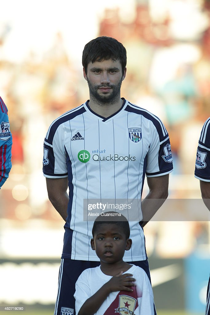<a gi-track='captionPersonalityLinkClicked' href=/galleries/search?phrase=Claudio+Yacob&family=editorial&specificpeople=4104249 ng-click='$event.stopPropagation()'>Claudio Yacob</a> of West Bromwich Albion during the singing of the national anthem during the friendly match between West Bromwich Albion and Sacramento Republic at Bonney Field on July 25, 2014 in Sacramento, California.