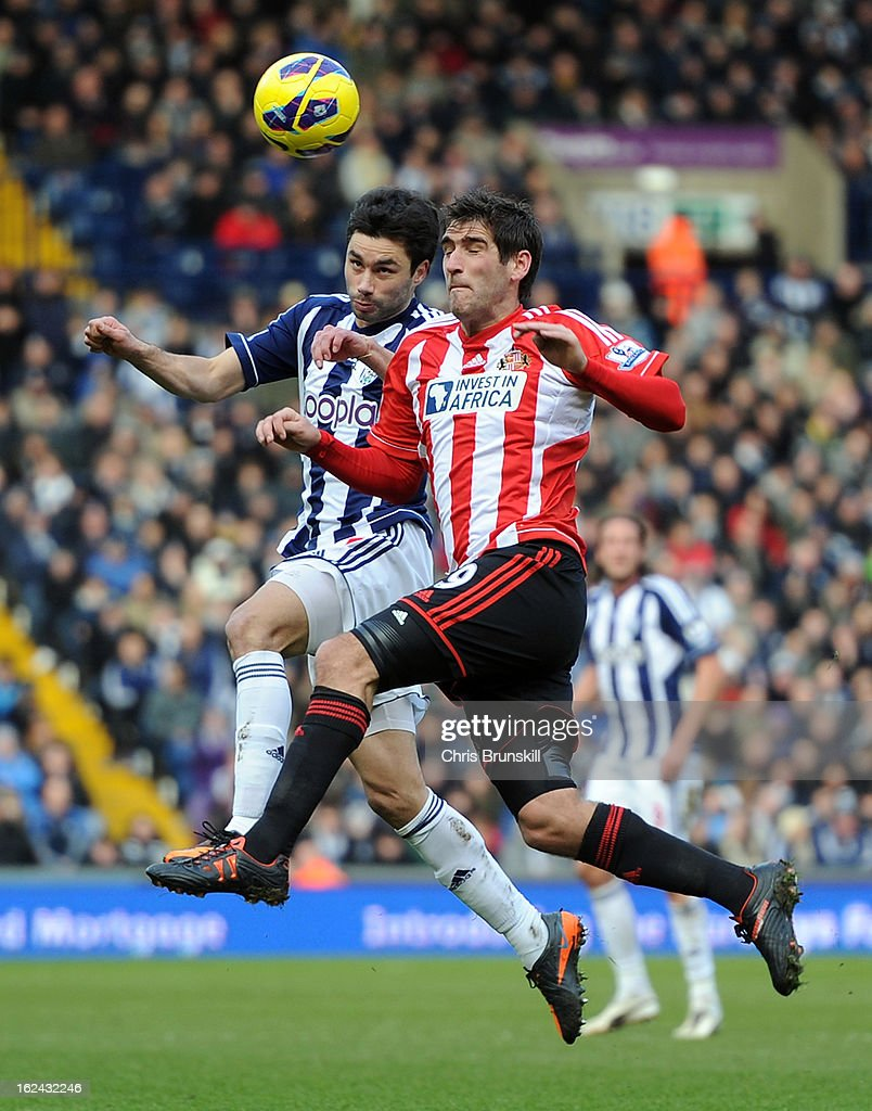 <a gi-track='captionPersonalityLinkClicked' href=/galleries/search?phrase=Claudio+Yacob&family=editorial&specificpeople=4104249 ng-click='$event.stopPropagation()'>Claudio Yacob</a> of West Bromwich Albion in action with Danny Graham of Sunderland during the Barclays Premier League match between West Bromwich Albion and Sunderland at The Hawthorns on February 23, 2013 in West Bromwich, England.