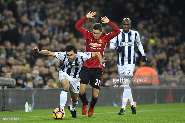 Claudio Yacob of West Bromwich Albion is fouled by Ander Herrera of Manchester United during the Premier League match between West Bromwich Albion...