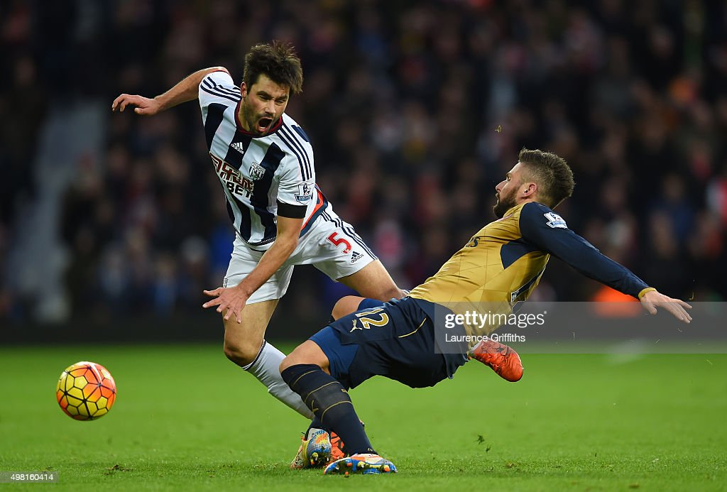 <a gi-track='captionPersonalityLinkClicked' href=/galleries/search?phrase=Claudio+Yacob&family=editorial&specificpeople=4104249 ng-click='$event.stopPropagation()'>Claudio Yacob</a> of West Bromwich Albion is tackled by <a gi-track='captionPersonalityLinkClicked' href=/galleries/search?phrase=Olivier+Giroud&family=editorial&specificpeople=5678034 ng-click='$event.stopPropagation()'>Olivier Giroud</a> of Arsenal during the Barclays Premier League match between West Bromwich Albion and Arsenal at The Hawthorns on November 21, 2015 in West Bromwich, England.