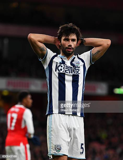 Claudio Yacob of West Bromwich Albion reacts to a missed opportunity during the Premier League match between Arsenal and West Bromwich Albion at...