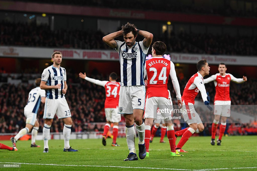 Claudio Yacob of West Bromwich Albion reacts to a missed opportunity during the Premier League match between Arsenal and West Bromwich Albion at Emirates Stadium on December 26, 2016 in London, England.