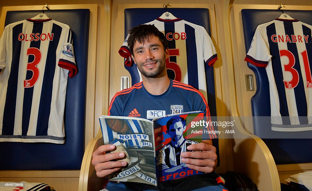 <a gi-track='captionPersonalityLinkClicked' href=/galleries/search?phrase=Claudio+Yacob&family=editorial&specificpeople=4104249 ng-click='$event.stopPropagation()'>Claudio Yacob</a> of West Bromwich Albion reads the programme in the home dressing room before the Barclays Premier League match between West Bromwich Albion and Chelsea on August 23, 2015 in West Bromwich, United Kingdom.
