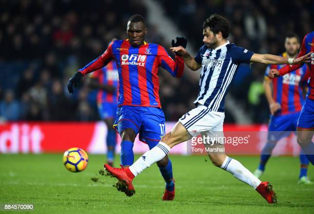 Claudio Yacob of West Bromwich Albion tackles Christian Benteke of Crystal Palace during the Premier League match between West Bromwich Albion and...