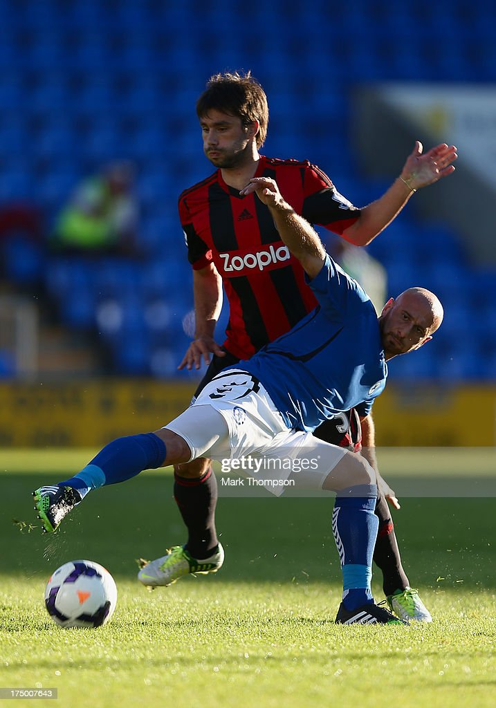 Claudio Yacob of West Bromwich Albion tangles with Dimitrios Papadopoulos of Atromitos during the pre-season friendly between West Bromwich Albion and Atromitosat Greenhous Meadow on July 29, 2013 in Shrewsbury, England.