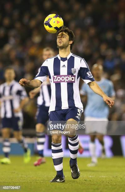Claudio Yacob of West Bromwich heads the ball during the Premier League match between West Bromwich Albion and Manchester City at The Hawthorns on...