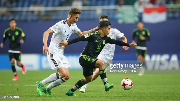 Claudio Zamudio of Mexico holds off a challenge from Phil Neumann of Germany during the FIFA U20 World Cup Korea Republic 2017 group B match between...