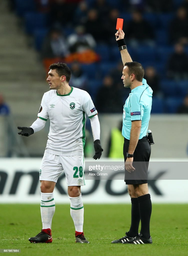 Claudiu Keseru of PFC Ludogorets Razgrad is shown a red card by referee Orel Grinfeld during the UEFA Europa League group C match between 1899 Hoffenheim and PFC Ludogorets Razgrad at Wirsol Rhein-Neckar-Arena on December 7, 2017 in Sinsheim, Germany.