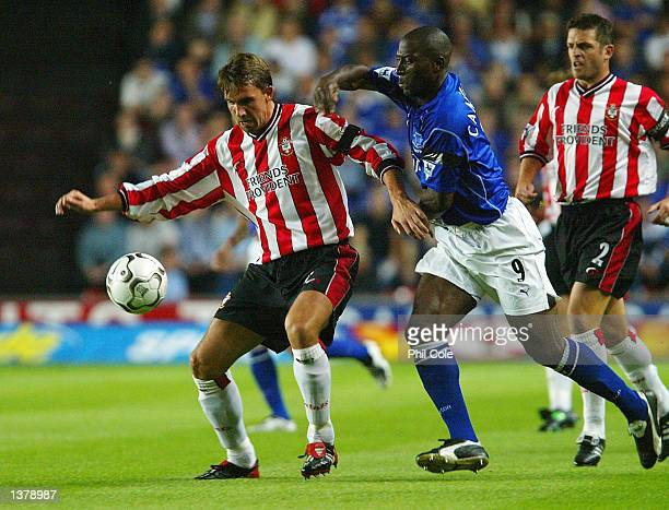 Claus Lundekvam of Southampton is tackled by Kevin Campbell of Everton during the FA Barclaycard Premiership match between Southampton and Everton at...