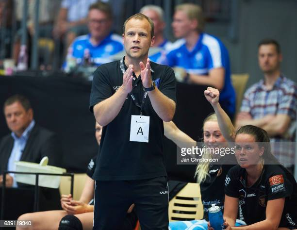 Claus Mogensen head coach of Copenhagen Handball looks on from the bench during the Primo Tours Ligaen 3 Final match between Nykobing Falster...