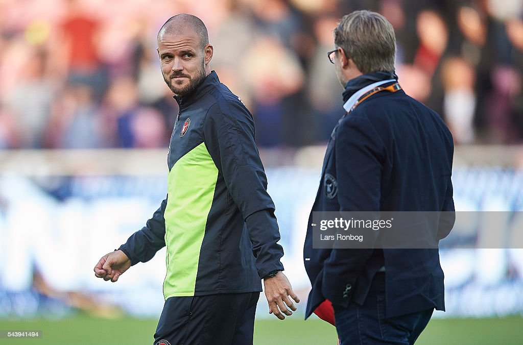 Claus Steinlein (R), sports director of FC Midtjylland and Kristian Bach Bak, assistant coach of FC Midtjylland walks off the pitch after the Europa League Qualifier match between FC Midtjylland and FK Suduva at MCH Arena on June 30, 2016 in Herning, Denmark.
