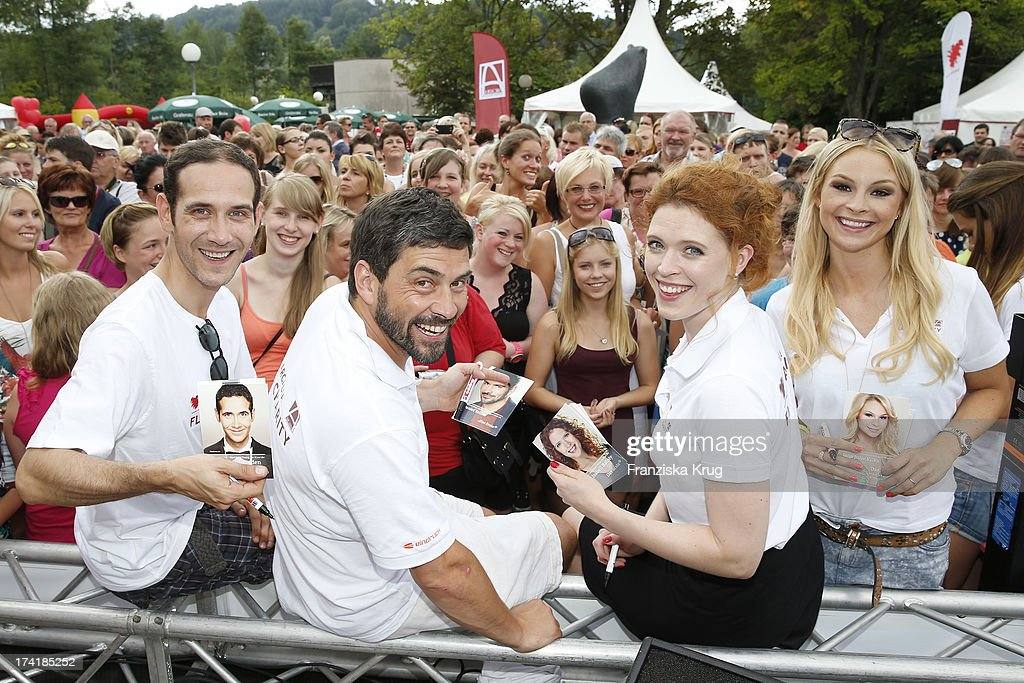 Claus Thull-Emden, Daniel Sellier, Janina Isabell Batoly and Jana Julie Kilka attend the Charity Event Benefitting Flood Victims on July 20, 2013 in Grafenau, Germany.