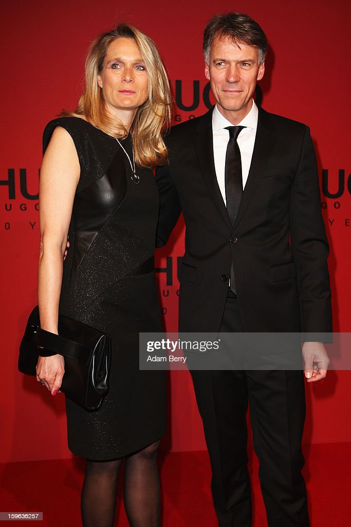 Claus-Dietrich and wife Iris Lars attends Hugo By Hugo Boss Autumn/Winter 2013/14 fashion show during Mercedes-Benz Fashion Week Berlin at The Brandenburg Gate on January 17, 2013 in Berlin, Germany.