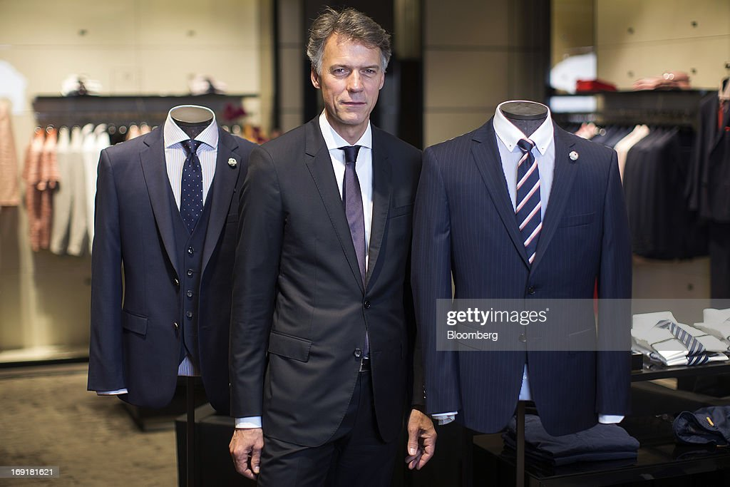 Claus-Dietrich Lahrs, chief executive officer of Hugo Boss AG, poses for a photograph following a Bloomberg Television interview at the company's store on Regent Street in London, U.K. on Tuesday, May 21, 2013. Hugo Boss AG reiterated its earnings forecast for the year after the German luxury-clothing maker said its retail business increased sales by 14 percent in the first quarter as it opened more outlets. Photographer: Simon Dawson/Bloomberg via Getty Images