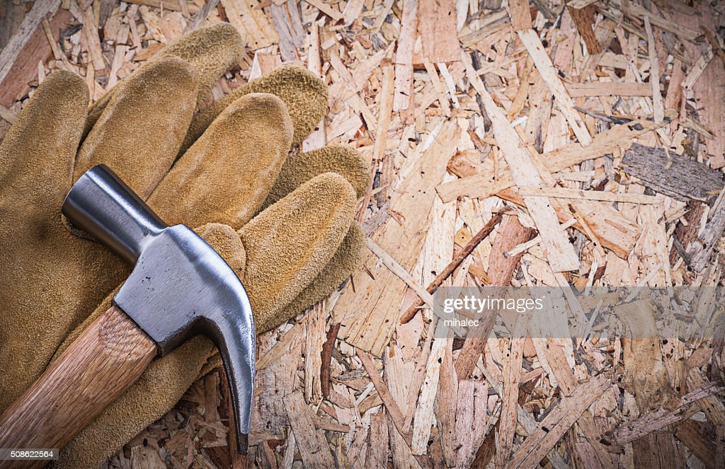 Claw hammer pair of leather safety gloves on OSB : Stock Photo