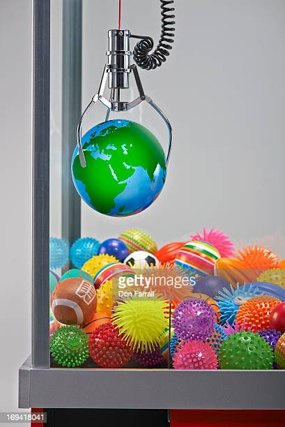 Claw Machine, holding a globe