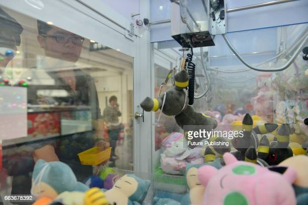 Claw machine master Chen Zhitong demonstrates how to beat claw machines in a mall on April 01 2017 in Xiamen China The 36yearold clerk found his...