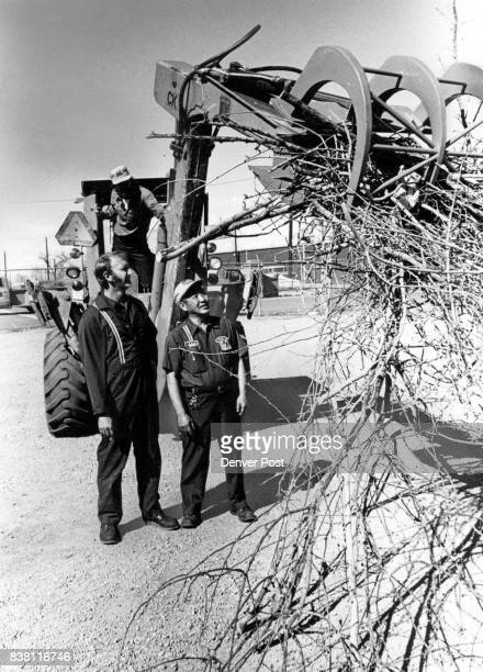 APR 1978 APR 26 198 'Claw' Readied For Spring Cleanup Bob Fagler left and Eddie Ito Littleton maintenance men examine claw they made for backhoe that...