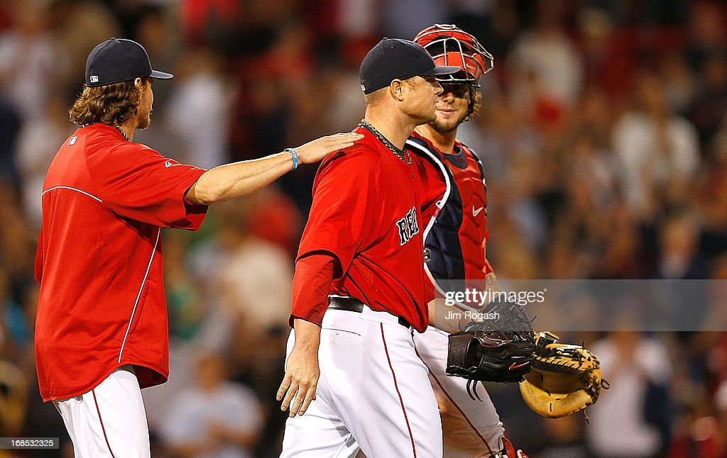 <a gi-track='captionPersonalityLinkClicked' href=/galleries/search?phrase=Clay+Buchholz&family=editorial&specificpeople=4424901 ng-click='$event.stopPropagation()'>Clay Buchholz</a> #11 of the Boston Red Sox and <a gi-track='captionPersonalityLinkClicked' href=/galleries/search?phrase=Jarrod+Saltalamacchia&family=editorial&specificpeople=836404 ng-click='$event.stopPropagation()'>Jarrod Saltalamacchia</a> #39 celebrate with and <a gi-track='captionPersonalityLinkClicked' href=/galleries/search?phrase=Jon+Lester&family=editorial&specificpeople=832746 ng-click='$event.stopPropagation()'>Jon Lester</a> #31 after he threw a one-hit shutout against the Toronto Blue Jays at Fenway Park on May 10, 2013 in Boston, Massachusetts.