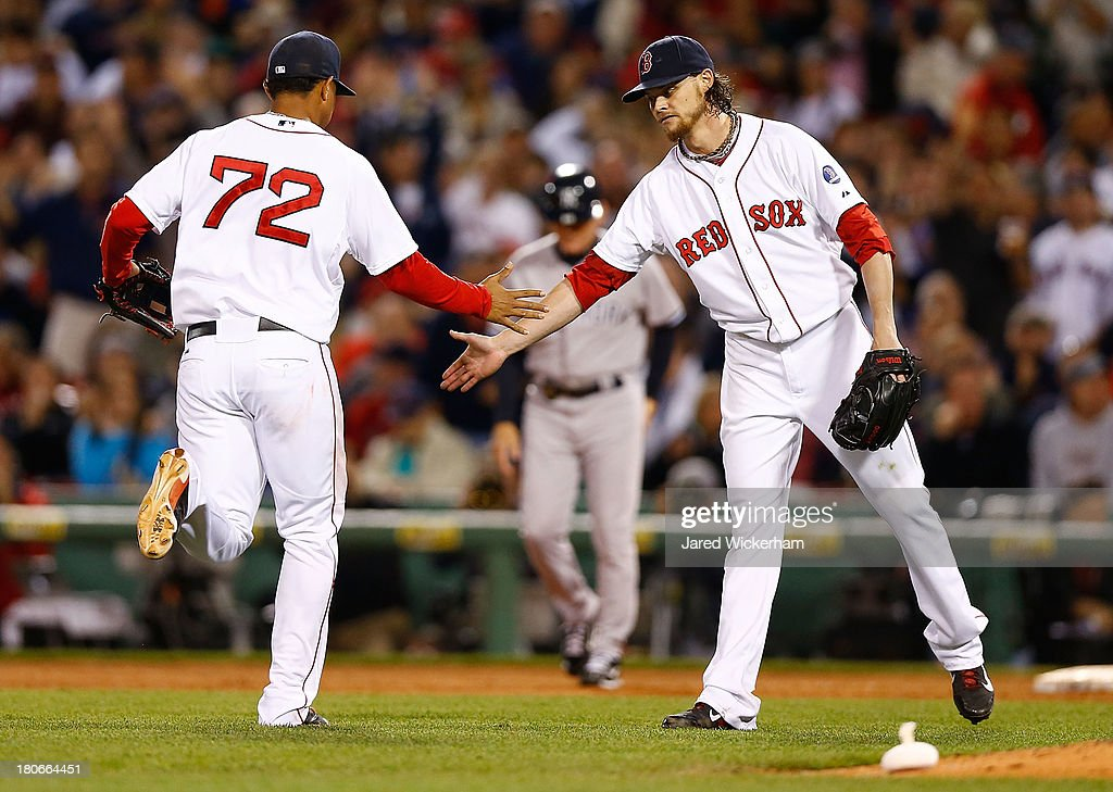 Clay Buchholz #11 of the Boston Red Sox congratulates teammate Xander Bogaerts #72 of the Boston Red Sox following a play in the fourth inning against the New York Yankees during the game on September 15, 2013 at Fenway Park in Boston, Massachusetts.