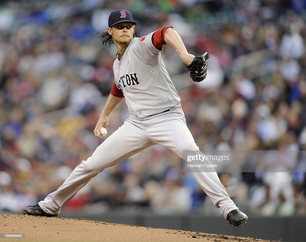 <a gi-track='captionPersonalityLinkClicked' href=/galleries/search?phrase=Clay+Buchholz&family=editorial&specificpeople=4424901 ng-click='$event.stopPropagation()'>Clay Buchholz</a> #11 of the Boston Red Sox delivers a pitch against the Minnesota Twins during the first inning of the game on May 17, 2013 at Target Field in Minneapolis, Minnesota.