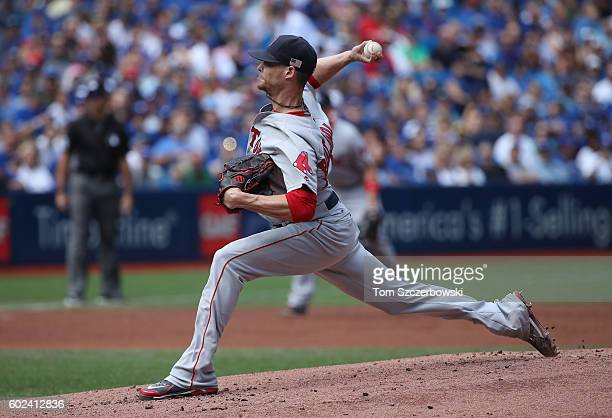 Clay Buchholz of the Boston Red Sox delivers a pitch in the first inning during MLB game action against the Toronto Blue Jays on September 11 2016 at...