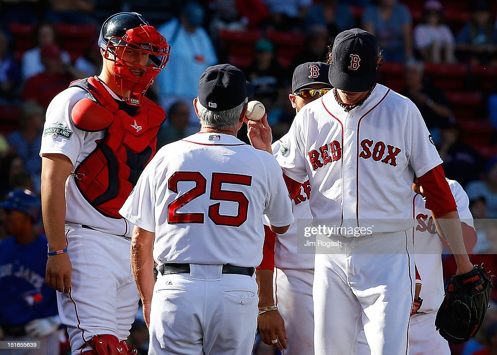 <a gi-track='captionPersonalityLinkClicked' href=/galleries/search?phrase=Clay+Buchholz&family=editorial&specificpeople=4424901 ng-click='$event.stopPropagation()'>Clay Buchholz</a> #11 of the Boston Red Sox hands the ball over to <a gi-track='captionPersonalityLinkClicked' href=/galleries/search?phrase=Bobby+Valentine&family=editorial&specificpeople=214135 ng-click='$event.stopPropagation()'>Bobby Valentine</a> #25 of the Boston Red Sox after the go-ahead run scored in the ninth by the Toronto Blue Jays at Fenway Park on September 9, 2012 in Boston, Massachusetts.