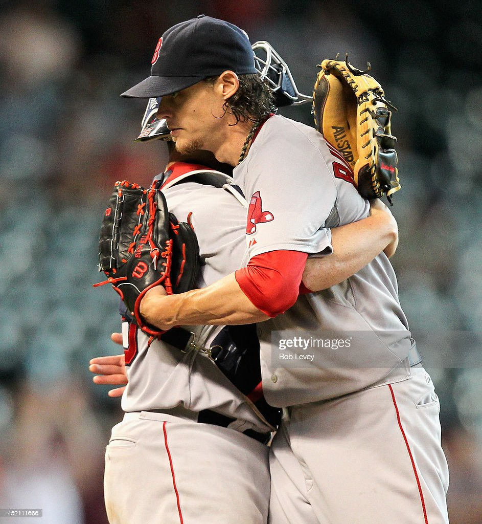 Clay Buchholz #11 of the Boston Red Sox hugs catcher Christian Vazquez #55 after the final out against the Houston Astros at Minute Maid Park on July 13, 2014 in Houston, Texas. Boston won 11-0.