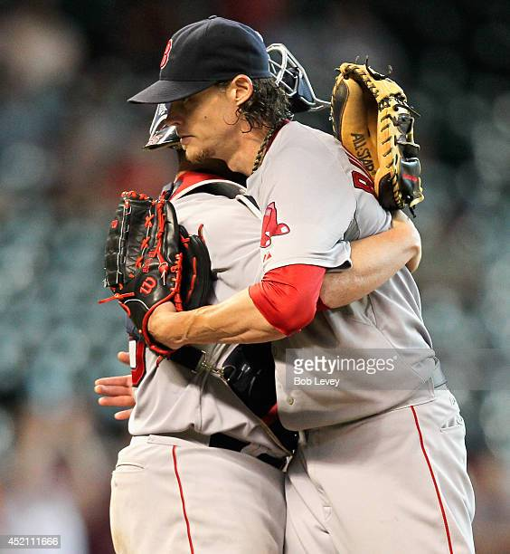 Clay Buchholz of the Boston Red Sox hugs catcher Christian Vazquez after the final out against the Houston Astros at Minute Maid Park on July 13 2014...